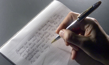 A-hand-writing-with-a-pen-006